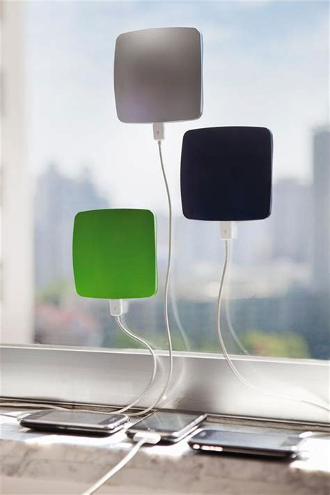 window solar phone charger by xd design