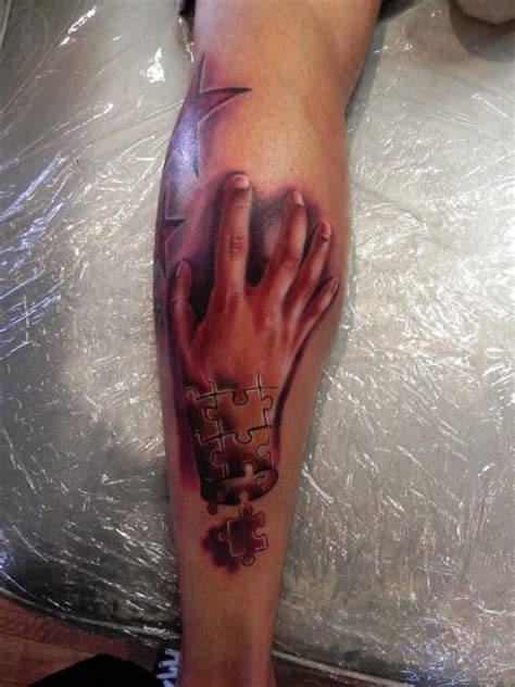 arm hand puzzle tattoo  rock ink