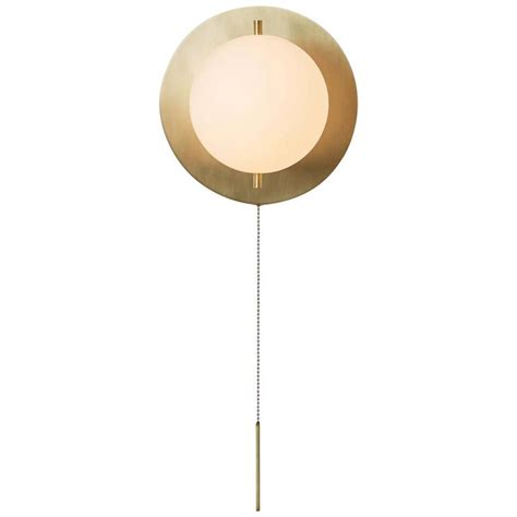 workstead signal sconce in brass with blown glass globe