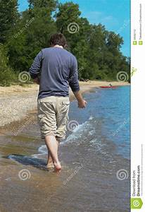 Young Man On The Beach Shore 2 Stock Photo - Image: 58592112
