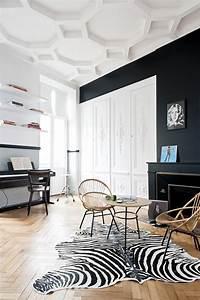 appartement ancien renove dans un style contemporain With tapis peau de vache avec canape en rotin d interieur