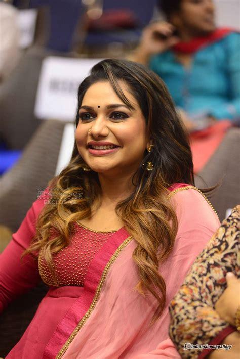 Rimi Tomy Actress Photos Stills Gallery