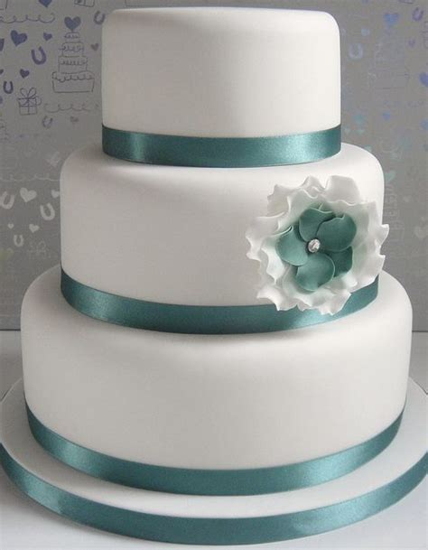 tier  white wedding cake  green ribbons