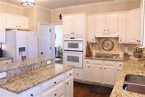 Granite countertop goes up the wall 2quot followed by row of for Kitchen colors with white cabinets with art clocks wall