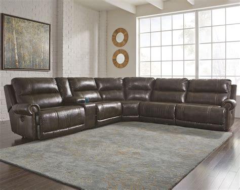 signature design by 6 power reclining sectional with storage console