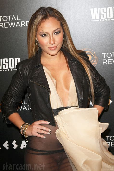sweater big minnie adrienne bailon exposes herself in a sheer ruffle front dress