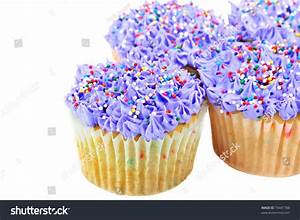 Fresh Baked Purple Cupcakes With Colorful Sprinkles ...