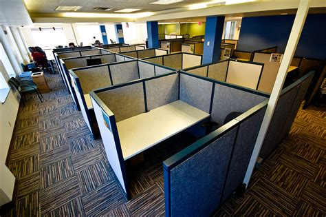 empty cubicles in a modern office building by office space planning