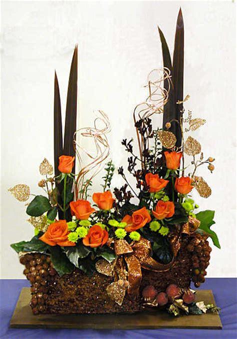 orange copper bronze christmas flower arrangement