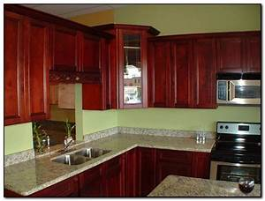 paint colors that go well with cherry wood cabinets With best brand of paint for kitchen cabinets with sofa wall art