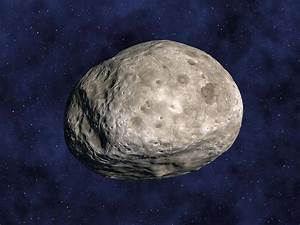 Asteroid Vesta, Artwork Photograph by Chris Butler