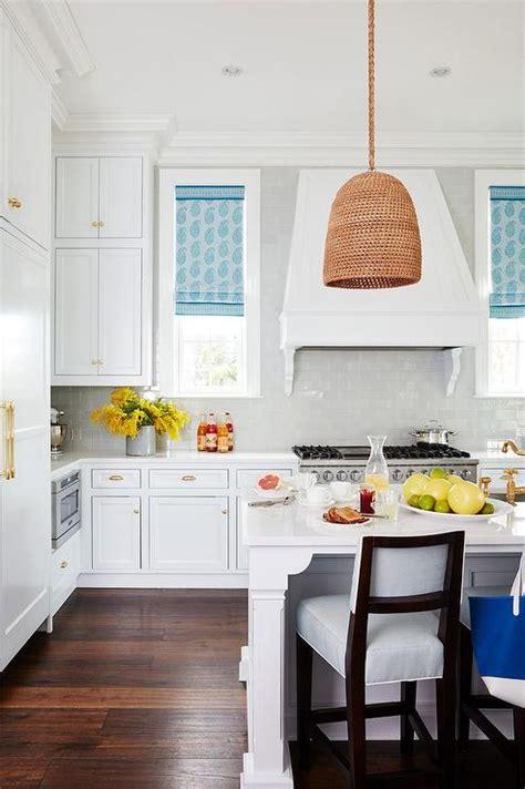 white kitchen  blue paisley roman shades cottage kitchen benjamin moore white diamond