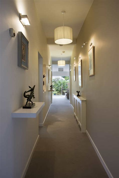 Hallway Illuminated With Drum Shade Pendants Wall