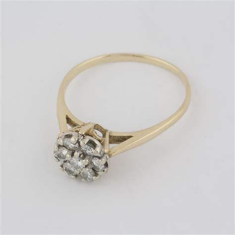 pre owned 14 karat yellow gold diamond flower style ring