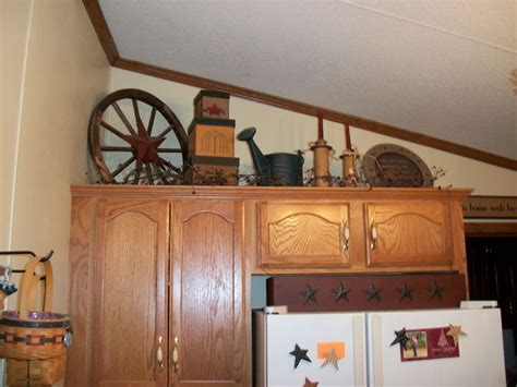 Primitive Decor Kitchen Cabinets primitive decorating above my kitchen cabinets