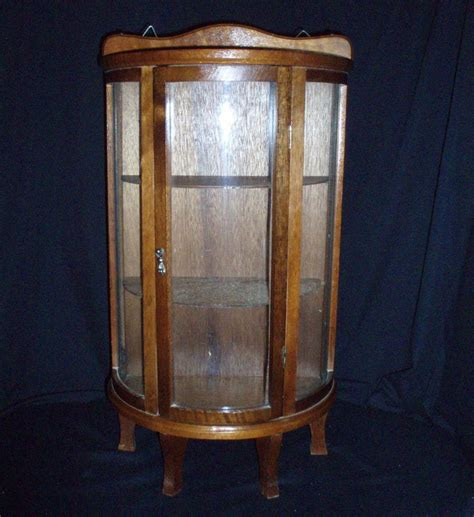 Vintage Curved Glass Curio Cabinet by Curio Cabinet