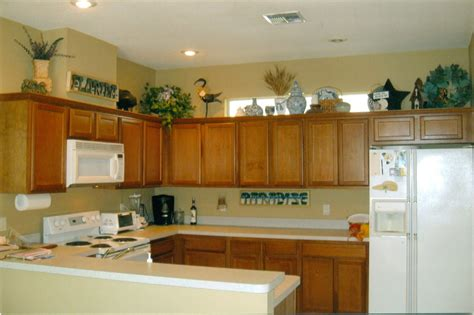 space above kitchen cabinets ideas ideas for decorating space above cabinets in kitchen