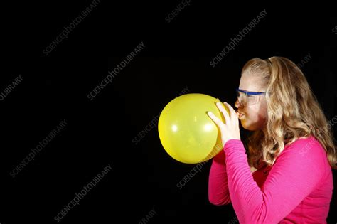 girl inflating balloon stock image  science