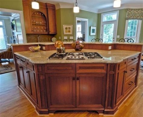kitchen island with cooktop and seating curved islands with seating and range search