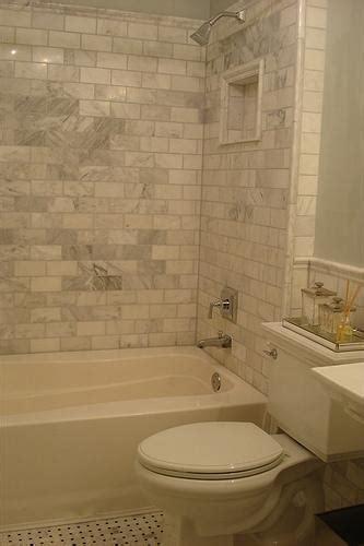 carrera marble subway tiles transitional bathroom