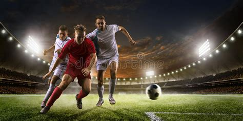 soccer players  action  sunset stadium background