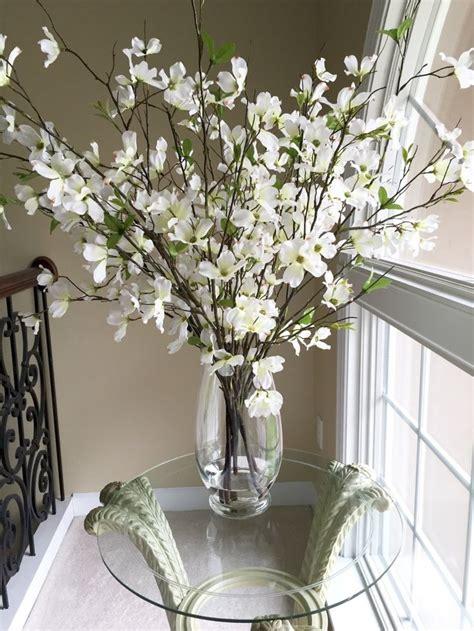 beautiful dogwood branches  large glass vase large