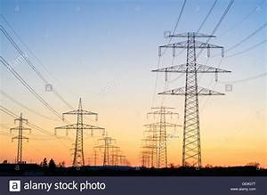 High voltage power lines pylon sunset energy Stock Photo ...
