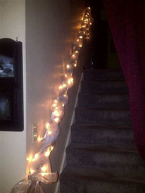 banister wrapped in lights tulle and shimmery wired