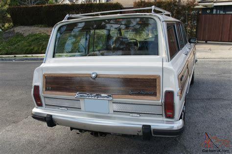 wood panel jeep 1986 jeep grand wagoneer w wood paneling white tan