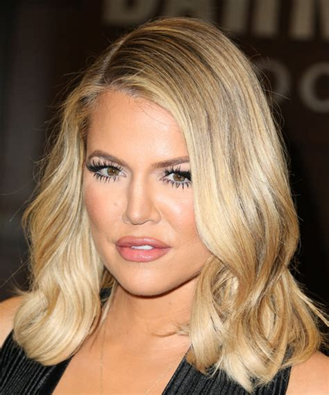 Khloe Kardashian Medium Wavy Blonde Hairstyle with Light ...