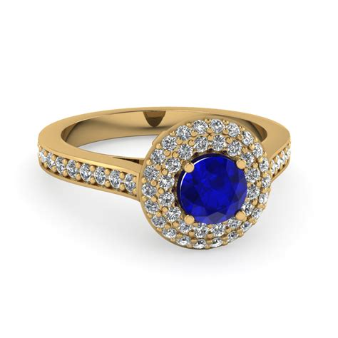 Round Cut Halo Diamond Ring With Blue Sapphire Gemstone In. New Rings. Eternity Band Ring. June Birthstone Engagement Rings. Ornament Necklace. Pear Pendant Necklace. Small Gold Pendant. Estate Rings. Gold Jewellery Online