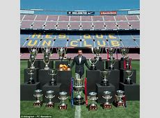 Barcelona legend Xavi poses with all 24 trophies won