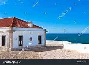 Turquoise Sea, Blue Sky And White House In Portugal. View ...