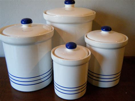 set  white eartenware kitchen canisters  blue stripes