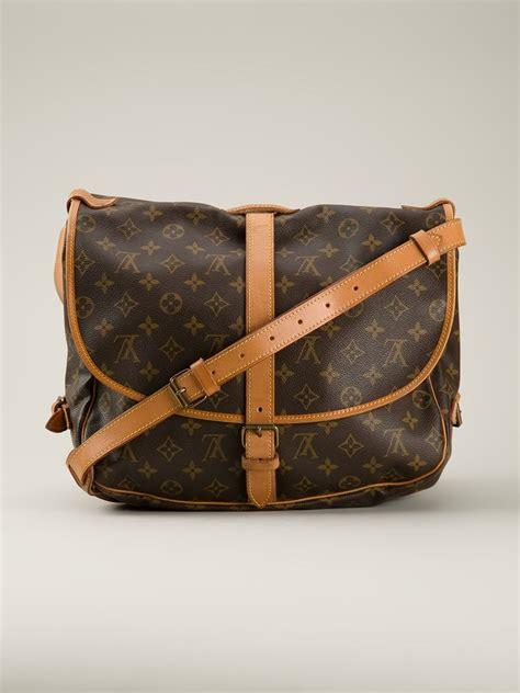 louis vuitton saumur  shoulder bag  brown lyst