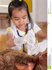 Asian Girl Playing Doctor Stock Photo - Image: 42731432