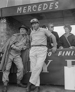 Juan Manuel Fangio talking to Mercedes team member Karl ...