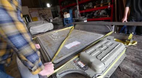 tearing   tesla model  battery pack video