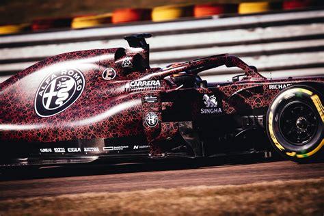 kimi raikkonen debuts  alfa romeo racing  car