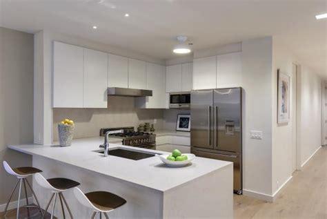 modern condo kitchen  crisp white cabinets hgtv