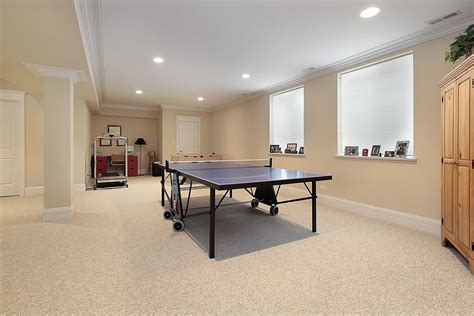 modern basement remodel design for gym room with white