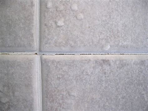 hometalk how do i repair cracked grout on shower walls