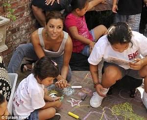 Eva Longoria puts her maternal instinct on show at charity ...