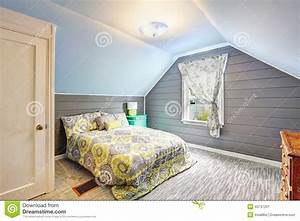 Bedroom With Vaulted Ceiling And Plank Paneled Walls Stock