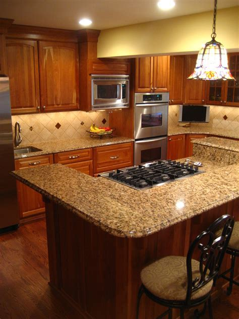 gold granite countertops Kitchen Traditional with Colonial