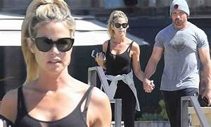 Denise Richards and boyfriend Aaron Phypers walk hand-in ...