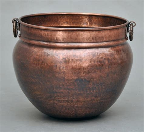 large copper planters hammered