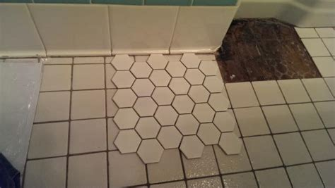 Alignment between new tile floor and existing cove base