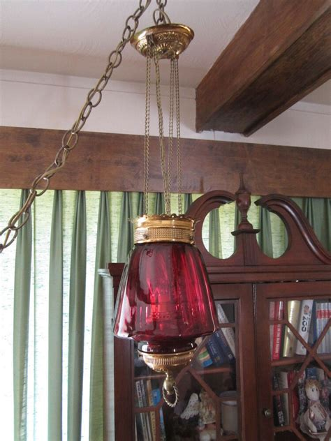 Hanging From The Chandeliers by Antique Late 1800 S Brass W Cranberry Glass Hanging