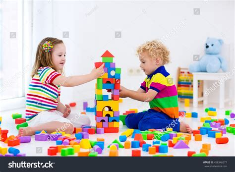 happy preschool age children play colorful stock photo 514 | stock photo happy preschool age children play with colorful plastic toy blocks creative kindergarten kids 458346577